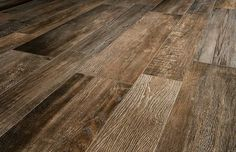 Fabricated porcelain brown wood tile with a matt finish suitable for internal floors and walls and externl wall except wet floor areas Grey Vinyl Plank Flooring, Vinyl Flooring Kitchen, Wood Effect Tiles, Wood Look Tile, Best Hardwood Floor Cleaner, Hardwood Floors, Small Log Homes, Log Home Kits, Mandarin Stone