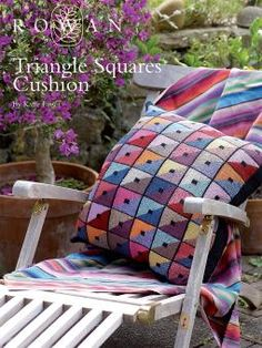 Triangle Squares Cushion. Another gorgeous (and free!) pattern by Kaffe Fassett, available to download from Rowan's website www.knitrowan.com