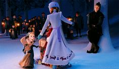 Kristoff dreamily gazing at Anna while she dances around with the children