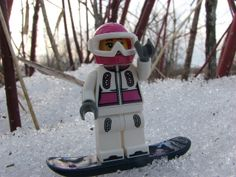 Lego Minifigure of a girl snowboarder