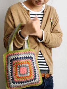 cardi + stripes tee + big granny crochet bag.