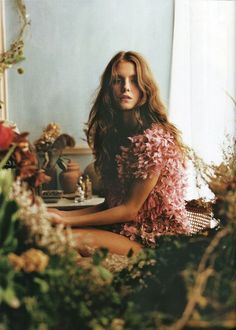 Create this in studio, with three different layers - foreground foliage, model, background pots and fake wall/curtain.