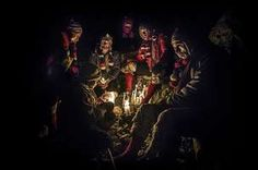 Qoyllur Rit'i (Peru's Snow Star Festival) - photo copyright Timothy Allen After leaving their crosses in the ice, groups of Ukukus descend to the base of the glacier to spend the night together huddled around candles. Timothy Allen