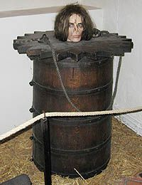 Barrel Pillory, or Spanish Mantle - A barrel is fitted over the entire body, with the head sticking out from a hole in the top. The person is kept locked in the barrel, forcing him to kneel in his own filth, and in some cases suffer extremes of hot or cold.    For a short time this was merely unpleasant, but prolonged confinement could cause death through hunger or thirst, or scaphism - allowing or encouraging insects to breed on and feed on the victim's flesh.