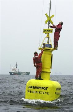Greenpeace activists place today a wind-gauge on a buoy at the North Sea. The information of this wind-gauge is transmitted directly to land. On-line you can see 'live' how many households can be provided with green energy, if at that moment one thousand wind turbines will be active at the North Sea.  Photographer: Greenpeace / Bas Beentjes