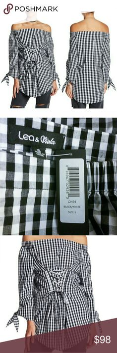 """NWT Anthropologie Off Shoulder Corset Tunic By Anthropologie brand, Lea & Viola, comes one of their hard to find extraordinary designs! The black & white gingham print tunic has elasticized shoulders only. There are long sleeves with self ties & a lace up corset waist. It is made of 100% cotton and is hand washable. The measurements were a bit tricky so they are approximate. Flat across are: off-shoulder to off-shoulder without stretch 19 1/4"""", bust 17"""", uncinched waist 16"""", cinched waist…"""