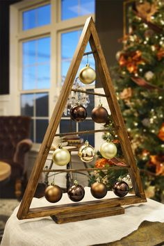 SALE: Use coupon code NOVEMBER10 to get 10% off!  This item is perfect for your own home Christmas décor and also makes a wonderful gift!  This beautiful wood Christmas tree can display 10 of your favorite ornaments. Both the frame and rods are made of wood and stained with a rustic brown. The tree comes assembled ready to be put on your mantel, shelf or table. Dimensions: Height- 26 inches, Width- 18 inches, Thickness- 1.5 inches (tree) and 3.5 inches (base) READY TO SHIP IMMEDIATELY…