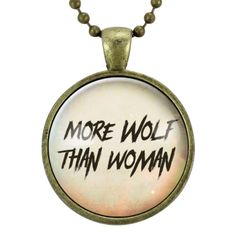 """This feminist handmade necklace pendant features the says, """"More wolf than woman."""" Pendant size is 25 mm (approximately 1 inch) and hangs from a matching 24-inch bronze plated ball chain. Fine art print sealed under a smooth glass cover. Handmade in the USA!"""
