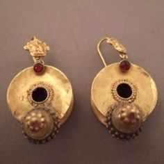 India | 20 ct gold, red glass paste | Originally these old earrings coming from Karnataka were worn on the lobe (ear plugs)