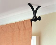 I am SO doing this.... ceiling mounted curtain rods.  Genius.    Ceiling mount curtain rod hardware.  Pottery Barn