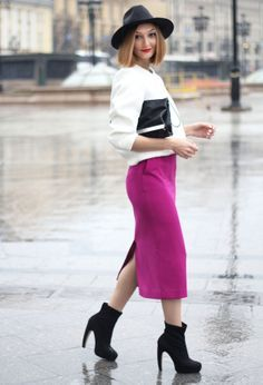 Fabulous fuchsia midi pencil skirt with a white top and black accessories.
