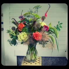 A new Simon Pearce vase filled with a natural mix of crocosmia, cockscomb, smokebush, hydrangea, various grasses, dill, tritoma and 'Malva' rose.  Roberts Flowers of Hanover, Hanover, NH