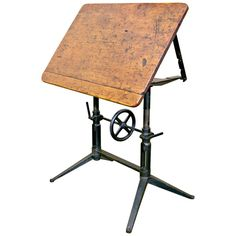 View this item and discover similar for sale at - Vintage WEM drafting table with original wood top and cast iron base having adjustable height and tilt from flat to vertical for a very versatile work