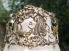 In The Garden  Wire Wrap Filigree Cuff  Bracelet. $54.00, via Etsy.