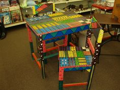 """Here is a cool whimsical table or desk with 2 chairs. There is a crack on the table top (see picture). The chairs are very sturdy. It is 32"""" L x 22"""" W x 28"""" H. Fun piece for a child's room or kitchen.   Only $50 Sold!"""