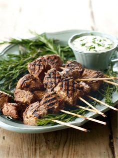 JUICY BEEF SKEWERS WITH HORSERADISH DIP: 1 lb beef rump,  1 ½ T red wine or balsamic vinegar, ¼ C olive oil,  1 teaspoon dried rosemary, 2 T worcestershire sauce, 2 T red port, 1 C creme fraiche (or sour cream), ½ tsp dijon mustard, ¼ tsp kosher salt, ¼ C chopped chives