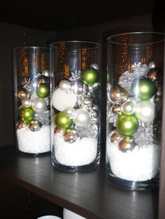 Holiday decorating & ideas - Hurricane vases filled with pinecones, ornaments and epsom salts