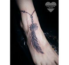 Feather bracelet tattoo on feet.