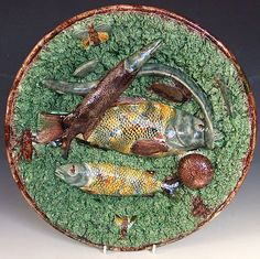 A wonderful and very large Portuguese Palissy Fish, urchin and insect motif circular charger, with lovely vivid and colourful mottled glazes. c1880  Dimensions in Inches: 16ins dia