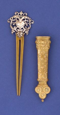 """This exquisitely handcrafted antique will be a highlight in any collection. The silver is hand carved with scroll detailing. The case is hand molded of bronze with a gold dore finish. The comb measures 4 5/8"""" in length, the silver part 1 ½"""" x 1 ½"""", the case 3 ½"""" x 7/8"""" x ½"""". Both are in excellent condition. The piece is not marked, a reputable jewelry assures that it is sterling.   Item ID: H-32"""