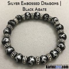 MANTRA: I am filled with the fire strength and courage. - 10mm Silver Dragon Etched Black Agate Natural Gemstones - Bali Silver Rondelles - Commercial Strength, Latex Free Elastic Band - Artisan Craft