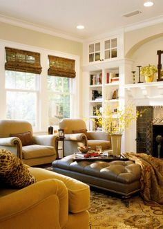 mustard yellow and bronze!!!!  good match!!!!!!!!!!!!           Beautiful Warm & Inviting Living Room - Beautiful rich color scheme.....love the area rug & how it ties everything together, love the leather ottoman, etc....  But no leopard print pillow for me.