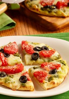 This Pesto and Tomato Grilled Pizza recipe is a family favorite! It's an easy and delicious weeknight dinner option.