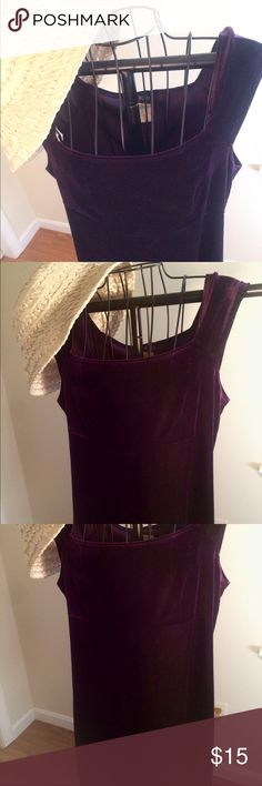 Medium velvet purple vintage tabloid dress Gently used condition. The label looks tattered but the dress itself looks excellent for mostly likely hailing from the 90s. Velvety texture. Cap sleeves. tabloid Dresses Midi