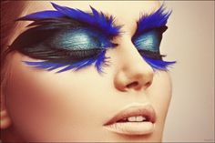 Black iridescent feathers and dark shimmery green for the blue eyeshadow. Eye and face Makeup Designs