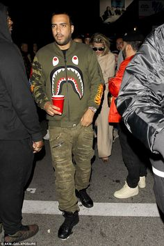 Don'r panic: French, real name Karim Kharbouch, opted for a striking khaki jacket which he teamed with distressed khaki pants and black boots