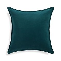 Neat and classic, this luxurious velvet pillow in beautiful teal adds the perfect mid-century modern accent to any room. Its rich, solid color and plush texture layer together and mixes well with coordinating patterns and solids.