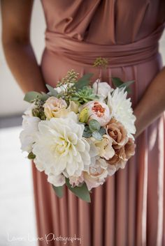 Textured bouquet, slightly unstructured, with native foliages, white dahlias, Julia garden roses, peach David austin roses, peach lisianthus and mint green succulents all compliment the bridesmaids latte coloured dress's
