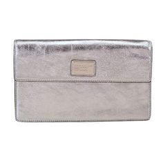 Marc by Marc Jacobs metallic leather clutch, $228, Saks Fifth Avenue.