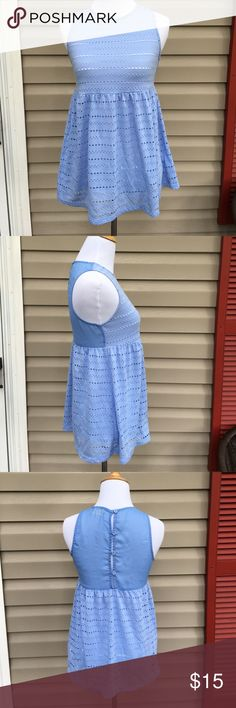 "Urban Outfitters pins and needles women's blue top Very nice blue eyelet empire waist top, sheer back that buttons up. 65% polyester 35% rayon, no snags, stains or holes. EUC. 16""W x 27""L Pins and Needles Tops"