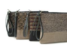 This casual, woven clutch bag with detachable, leather wrist strap blends modern fabrics, simple styling and a neutral color palette. Black Clutch Bags, Clutch Purse, Tote Bag, Crossbody Bag, Satchel, Fashion Handbags, Fashion Bags, Balenciaga, Best Leather Wallet