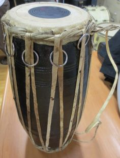 African Chamba hand drum, with rings in the verticals, leather tuning, top head about high. African Drum, Hand Drum, Skin Head, Percussion, Drums, Hand Carved, Carving, Clay, Hands