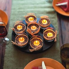 Easy fall centerpiece - Take some juice glasses and add some orange candles. Fill with dry beans and tie a raffia ribbon around the glasses. Diy Thanksgiving Centerpieces, Votive Centerpieces, Fall Wedding Centerpieces, Simple Centerpieces, Votive Candles, Centerpiece Ideas, Candle Arrangements, Reception Decorations, Tea Lights