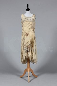 Beaded ivory chiffon flapper dress with butterfly beading, circa 1928, with large butefly motifs in beige, silver and white, Kerry Taylor Auctions