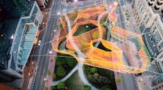 This video interview with Janet Echelman will give you insight into the artist and how her fiber sculptures are created.