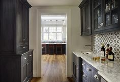 Butlers pantry ideas kitchen traditional with wood floor carrera marble counter white oak island