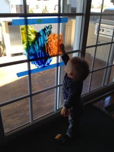 Toddler Painting - no mess. Put paint in a 2 1/2 gallon Ziploc bag, using painters tape, tape bag to sliding doors and let the creativity start. My 16 month old played with this for days.
