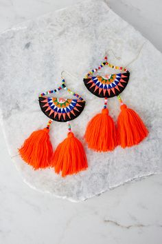 Looking to Make Some Moves on your next outing? Let your ears do some of the work for you, with these adorable tassel earrings. You haven't really lived until you've dangled your way to a good time.  • Imported