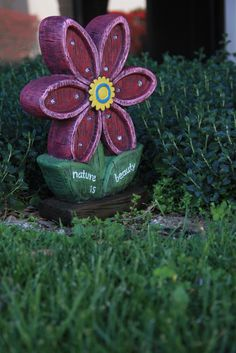 Resin flower statuary that is solar powered and lights up automatically at dusk!