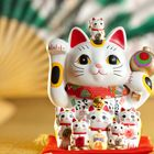 """5 interesting facts about the Maneki Neko -- the paw-waving """"Fortune Cats"""" you see in Asian restaurants."""