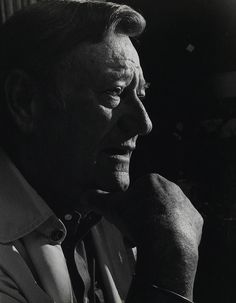 John Wayne. This picture reminds me very much of my grandfather. The expression, the pose.... :)