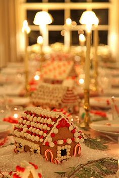Decor your holiday table with several gengerbread houses! Cute!!!