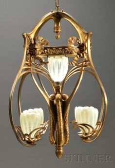 Art Nouveau Chandelier Gilt metal and art glass Early 20th century, Europe Gilt fixture with ormolu bows, cutouts, shaped arms with five opalescent shades, one decorative element joint separated,