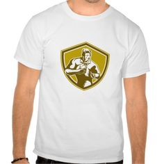 Rugby Player Running Fending Shield Retro Tshirt. Illustration of a rugby player holding ball running charging fending viewed from front set inside shield crest on isolated background done in retro style. #Illustration #RugbyPlayerRunningFending #rwc #rwc2015 #rugbyworldcup