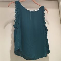 Short waisted tank top Emerald green short waisted tank top with lace detail on sleeve. Dry clean only. Lush Tops Tank Tops