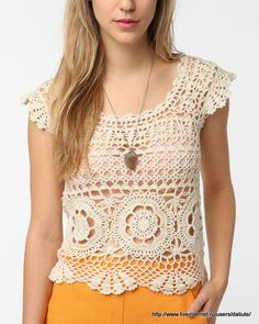 This top is so feminine and beautiful. I found it at this site. I have the patterns and some directions to get you started of how I would t...